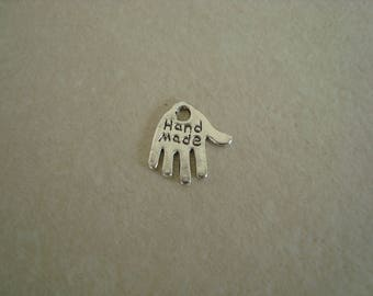Silver coloured metal hand charm