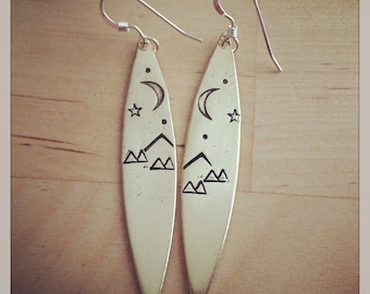 Petroglyph earrings sterling silver and bronze hand stamped earrings mountaintime