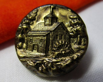 0309-A - Log Cabin Building with Flag on Roof, Water Wheel, Surrounded by Trees and Lake Vintage Brass Pictorial Button