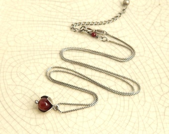 Tiny flower necklace, carnelian necklace, hand-cut sterling silver flower necklace with red stone.