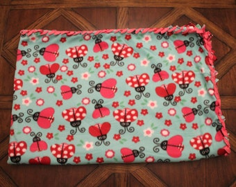 ladybugs & flowers fleece blanket