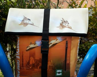 Backpack from banners recycled.Special design with city in different ranges of autumn colors.Unique design with airplanes.