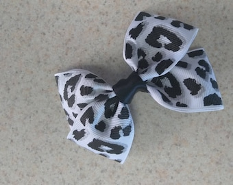 Leopard black and white hair bows . Any style any color . Beautiful for any occasion.many more to come!!