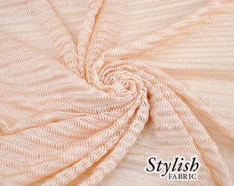 Light Peach Arrowhead Stretch Knit Fabric  - 1 Yard Style 6019