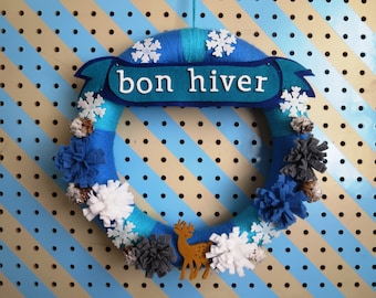 """Bon Hiver - 12"""" French Winter Wreath in Cloud Blue/ Turquoise with Felt Banner, Glitter Snowflakes, and Mini Pinecones"""