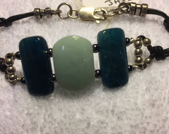 Bracelet, sterling silver, jade, leather
