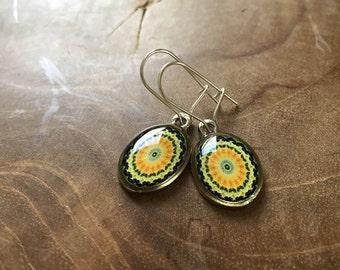 Mandala dangeling earrings: green, blue, yellow and orange. Oval.