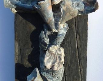 Seashells and old barn wood make this a unique Cross, sculptured from naturally broken seashells, unique Crucifix, rustic wall decor