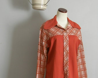 Orange womens polyester button down shirt from the 1970s