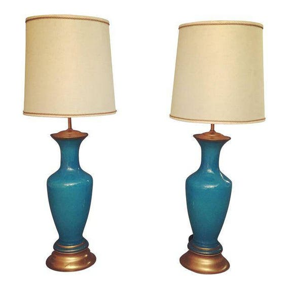 Italian Pair Of Blue Glass Lamps with gilded wood base.