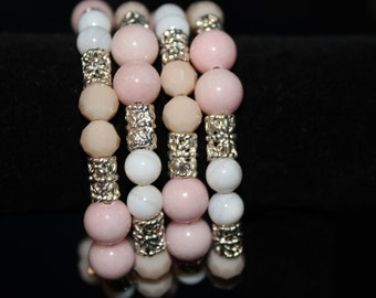 Peachy-pink and white beaded memory wire bracelet