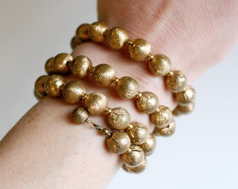 1930s art deco brass beaded wrap bracelet / 30s vintage brass coil bangle / antique gold brass wrapped bead patina bracelet