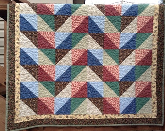 Sofa patchwork quilt red green blue brown triangles in chevron design