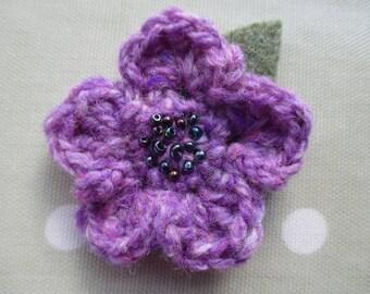 Crocheted woollen flower corsage brooch
