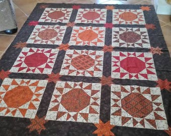 This beautiful scrappy quilt top is made from rich fall colors
