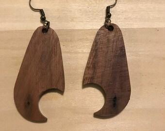 Walnut earrings with iron hardware.