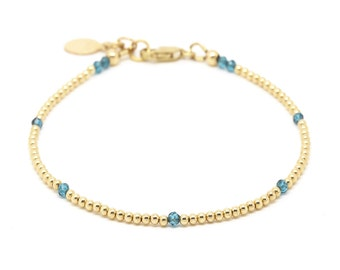 London Blue Topaz & gold bead bracelet.