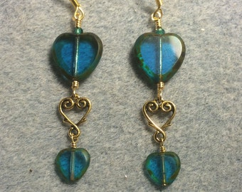 Large and small matching turquoise Czech glass heart bead dangle earrings joined by a gold Tierracast heart connector charm.