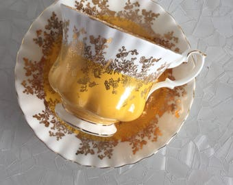 Royal Albert Regal series yellow gold gilt tea cup and saucer