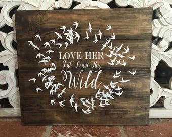 Atticus love her wild wood sign
