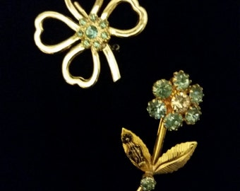 2 Gold tone flower pins with blue stones,shamrocks and daisies. Vintage beauty.