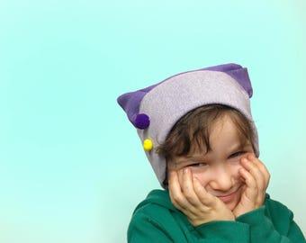 Baby hat in purple cotton sweatshirt with yellow pom pom and purple