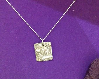 Reticulated silver pendant
