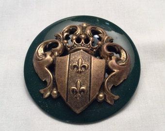Vintage Green Plastic and Goldtone Crest Brooch Pin