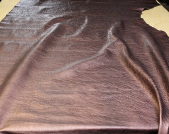Burgundy metallic milled pebble cowhide leather 2.5-3oz. Perfect for handbags, shoes and leather crafts