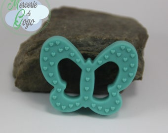 Teething ring, shaped light blue butterfly.