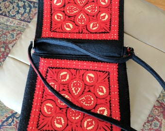 Vintage black, red, and cream colored applique felt purse.