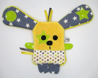 The toy yellow green grey