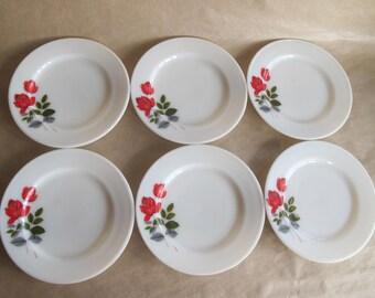 Six JAJ Pyrex June Rose sandwich plates.