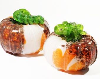 orange and white speckled pumpkin