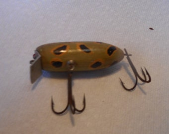 Vintage Wood Surface Fishing Lure, Green with Black & Gold Markings.