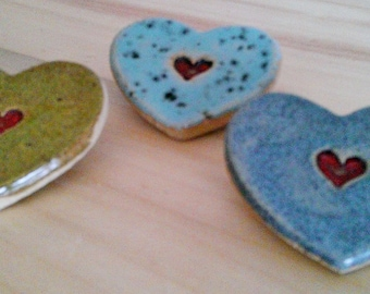 Heart brooches
