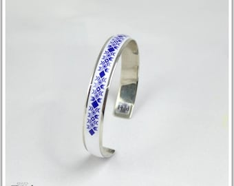 Bangle is plated silver Inka Maria Navy Blue and white