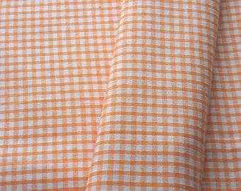 "a beautiful cut of cotton fabric ""orange gingham"""