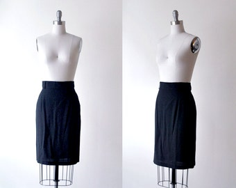 1980's pencil skirt. 80's black skirt. mid-length. rayon skirt. small. 80 black pencil skirt.