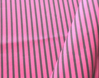"a beautiful cut of cotton fabric ""black stripes on fuchsia"""