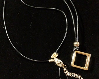 Chico's Black cord necklace with geometric Cube gold tone