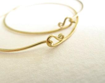 18k gold endless hammered solid gold hoop earrings 2 inch 18 karat 18 gauge artisan hoops metalsmith
