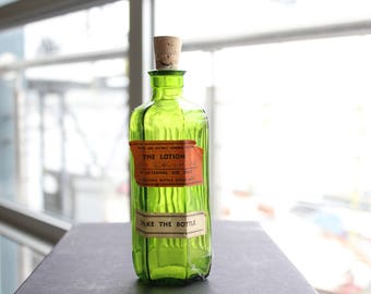 Vintage green lotion bottle with cork stopper british bottle apothecary bottle