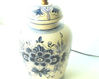Boho vintage 70s beige ceramic, portable , table lamp with a hand pained blue , folk flowers.