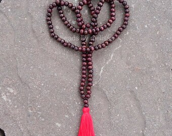"40"" wood bead necklace with red tassel"