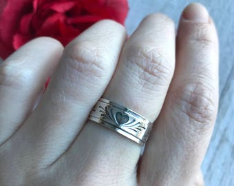 Sterling silver wide band with hearts stamped all tbe way around. Made to order in your size!