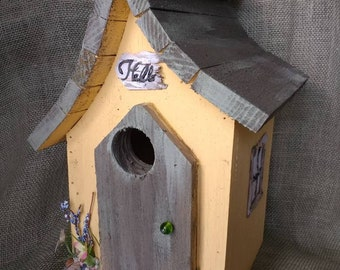 Yellow and grey birdhouse. Outdoor protectant, easy bottom clean out and hanger. Made in Michigan. Fast shipping!
