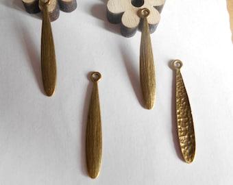 x 4 Teardrop pendants bronze 39 x 6 mm