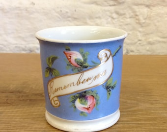 Vintage Victorian Remember Me Mug / Cabinet Cup. Blue with White Scroll and Pink Flowers Very Good Condition.