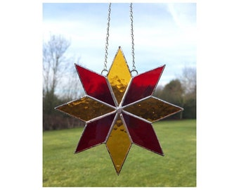 Stained glass red and orange star suncatcher decoration